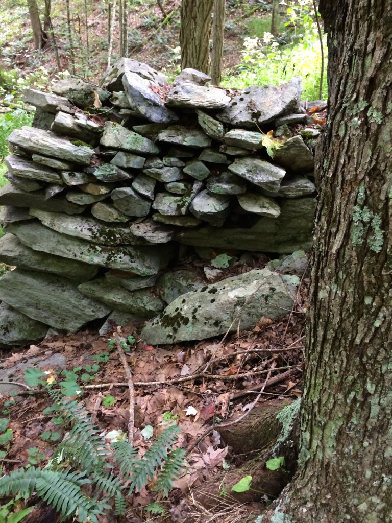 Stacked rock formations lie on the banks