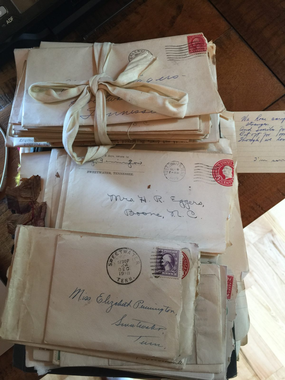 Stack of letters, some wrapped in ribbon